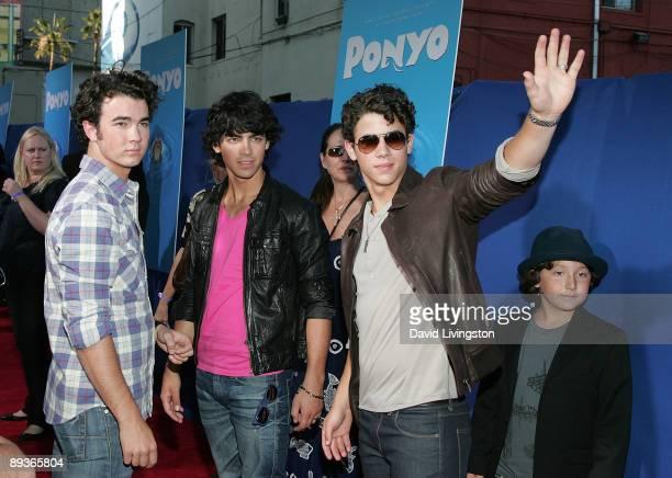 Jonas Brothers band members Kevin Jonas Joe Jonas and Nick Jonas and their brother Frankie Jonas attend an industry screening of Walt Disney...