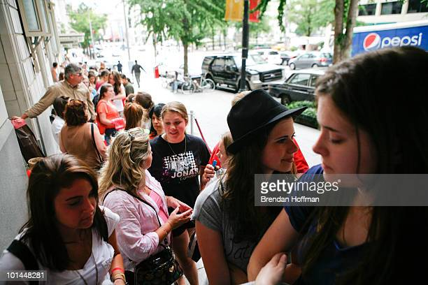 Jonas Brothers fans wait for free show tickets for the Live Nation NSF Event at the Warner Theatre on June 1 2010 in Washington DC