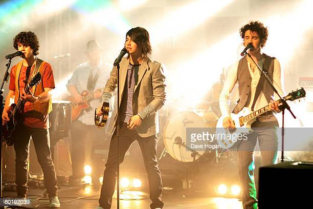 Jonas Brothers Nick Joe and Kevin perform a showcase at a Universal Records conference in Chandler's Cross on March 10 2008 near London England