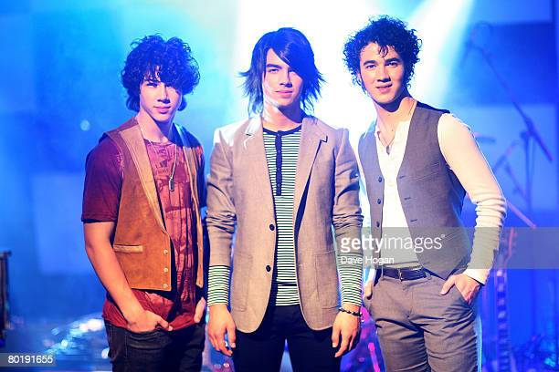 Jonas Brothers Nick Joe and Kevin pose prior to a showcase at a Universal Records conference in Chandler's Cross on March 10 2008 near London England