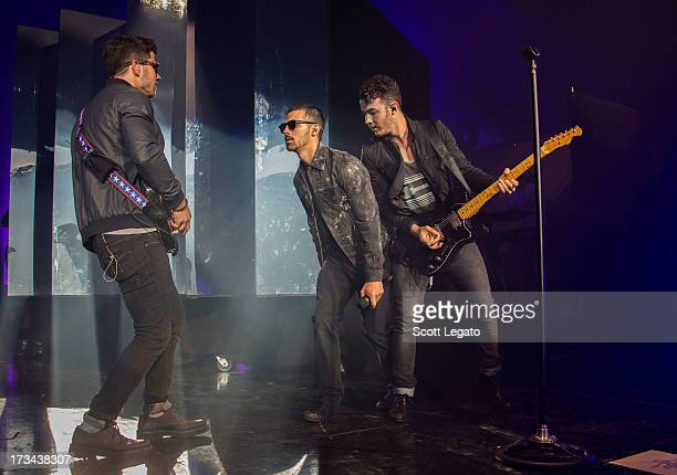 Jonas Brothers performs at DTE Energy Music Theater on July 13 2013 in Clarkston Michigan