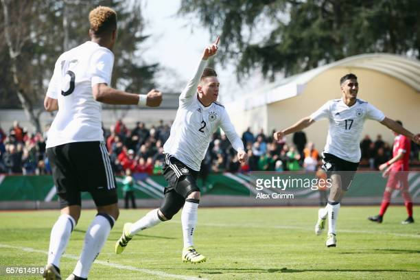 Jonas Busam of Germany celebrates his team's second goal during the UEFA Elite Round match between U19 Germany and U19 Serbia at Sportpark on March...