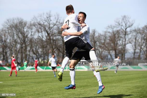 Jonas Busam of Germany celebrates his team's second goal with team mate Dominik Franke during the UEFA Elite Round match between U19 Germany and U19...