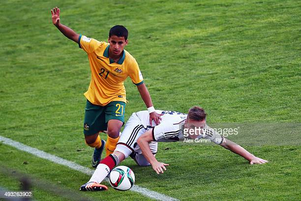 Jonas Busam of Germany is challenged by Daniel Arzani of Australia during the FIFA U17 World Cup Chile 2015 Group C match between Australia and...