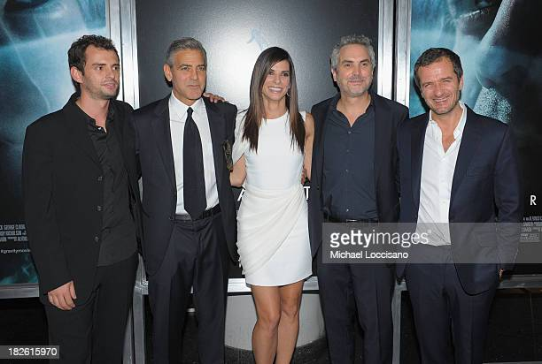 """Jonas Cuaron, George Clooney, Sandra Bullock, Alfonso Cuaron and David Heyman attend the """"Gravity"""" premiere at AMC Lincoln Square Theater on October..."""