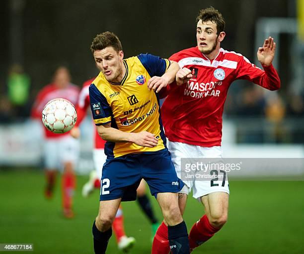 Jonas Damborg of Hobro IK and Jens Martin Gammelby of Silkeborg IF compete for the ball during the Danish Alka Superliga match between Hobro IK and...