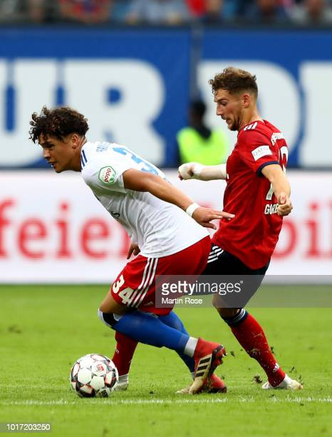 Jonas David of Hamburg and Leon Goretzka of Muenchen battle for the ball during the Friendly match between Hamburger SV FC Bayern Muenchen at...