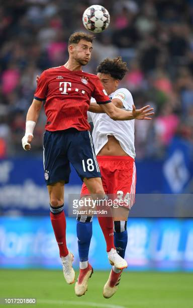 Jonas David of Hamburg is challenged by Leon Goretzka of Muenchen during the friendly match between Hamburger SV and Bayern Muenchen at...