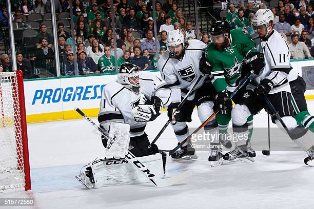 Jonas Enroth Drew Doughty and Anze Kopitar of the Los Angeles Kings try to keep a goal out of the net against Patrick Eaves of the Dallas Stars at...