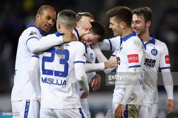 Jonas Foehrenbach of Karlsruhe celebrates his team's third goal with team mates during the 3 Liga match between Karlsruher SC and SG Sonnenhof...
