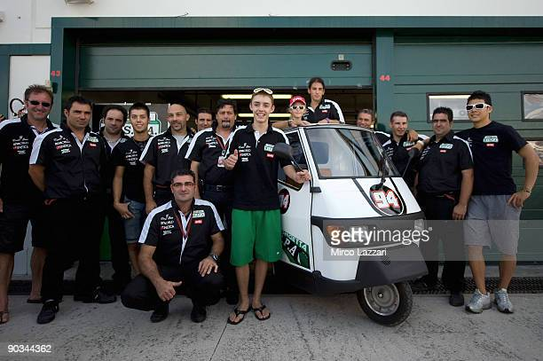Jonas Folger of German and Ongetta Team Ispa receives the 'Ape Piaggio' in gift from the team with the same colours of the bike before the free...