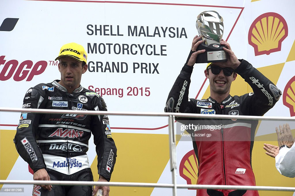 Jonas Folger of Germany and Arginano & Gines Racing celebrates the third place on the podium at the end of the Moto2 race during the MotoGP Of Malaysia at Sepang Circuit on October 25, 2015 in Kuala Lumpur, Malaysia.