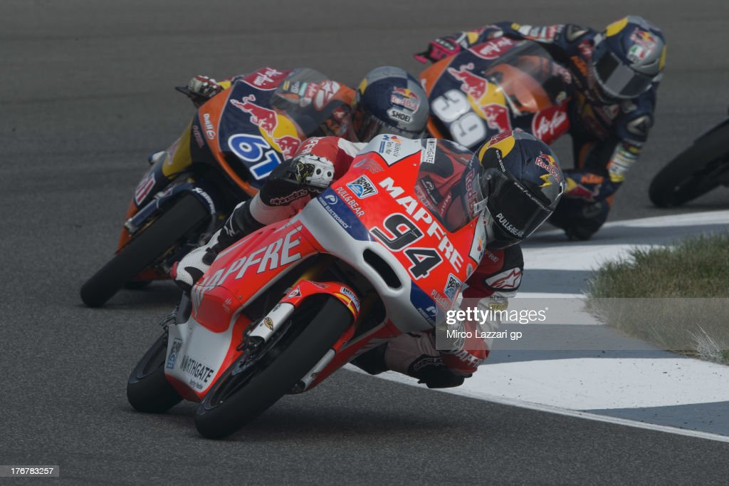 Jonas Folger of Germany and Kalex KTM Team Aspar leads the field during the Moto3 race during the MotoGp Red Bull U.S. Indianapolis Grand Prix - Race at Indianapolis Motor Speedway on August 18, 2013 in Indianapolis, Indiana.