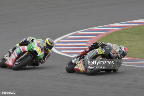 Jonas Folger of Germany and Monster Yamaha Tech 3 leads Aleix Espargaro of Spain and Aprilia Racing Team Gresini during the MotoGP race during the...