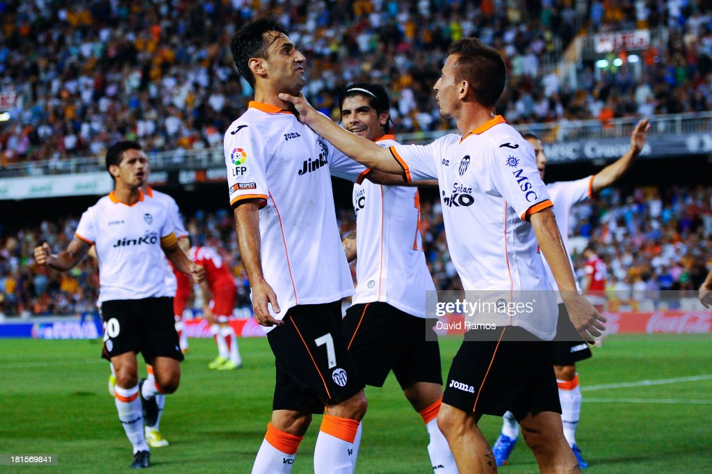 Jonas Goncalves (L) of Valencia CF celebrates after scoring the opening goal during the La Liga match between Valencia CF and Sevilla FC at Estadio Mestalla on September 22, 2013 in Valencia, Spain.