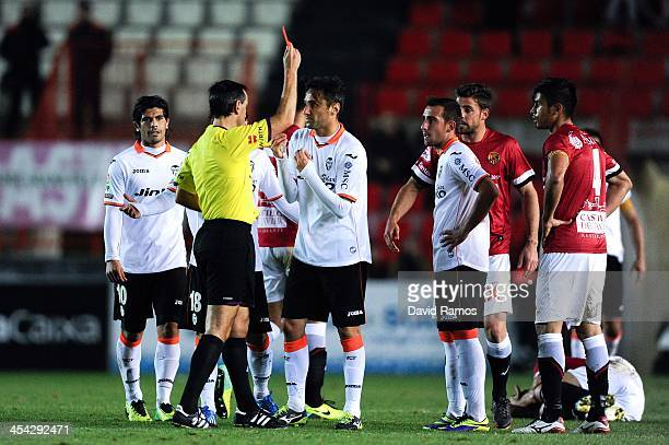 Jonas Goncalves of Valencia CF is shown a red card by the referee Jose Antonio Teixeira during the Copa del Rey round of 32 match between Gimnastic...