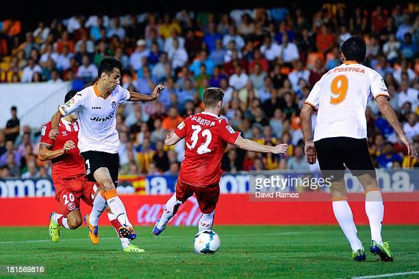 Jonas Goncalves of Valencia CF scores the opening goal during the La Liga match between Valencia CF and Sevilla FC at Estadio Mestalla on September...