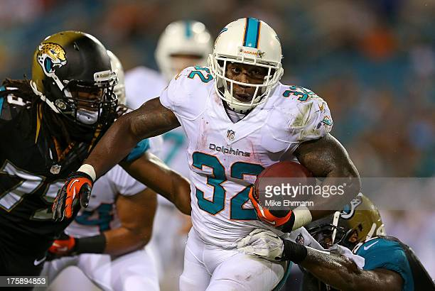Jonas Gray of the Miami Dolphins rushes during a preseason game against the Jacksonville Jaguars at EverBank Field on August 9 2013 in Jacksonville...