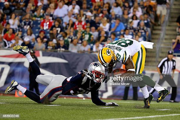 Jonas Gray of the New England Patriots attempts to tackle Ty Montgomery of the Green Bay Packers in the second half during a preseason game at...