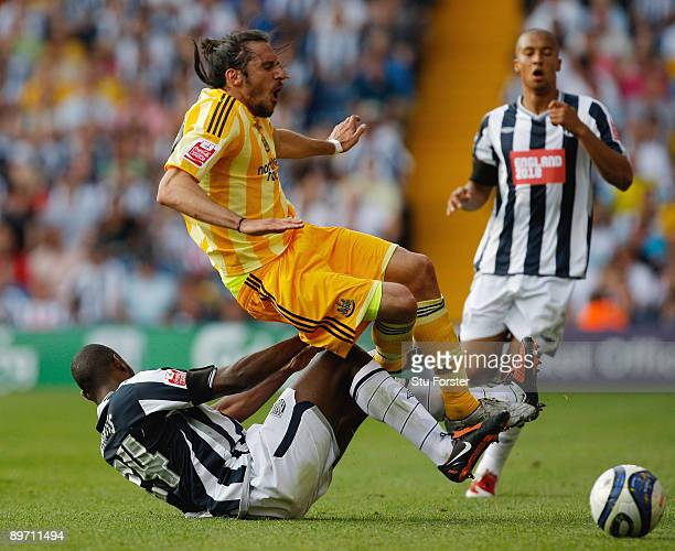 Jonas Guitierrez of Newcastle is fouled by Shelton Martis of West Brom during the Coca Cola Championship game between West Bromwich Albion and...