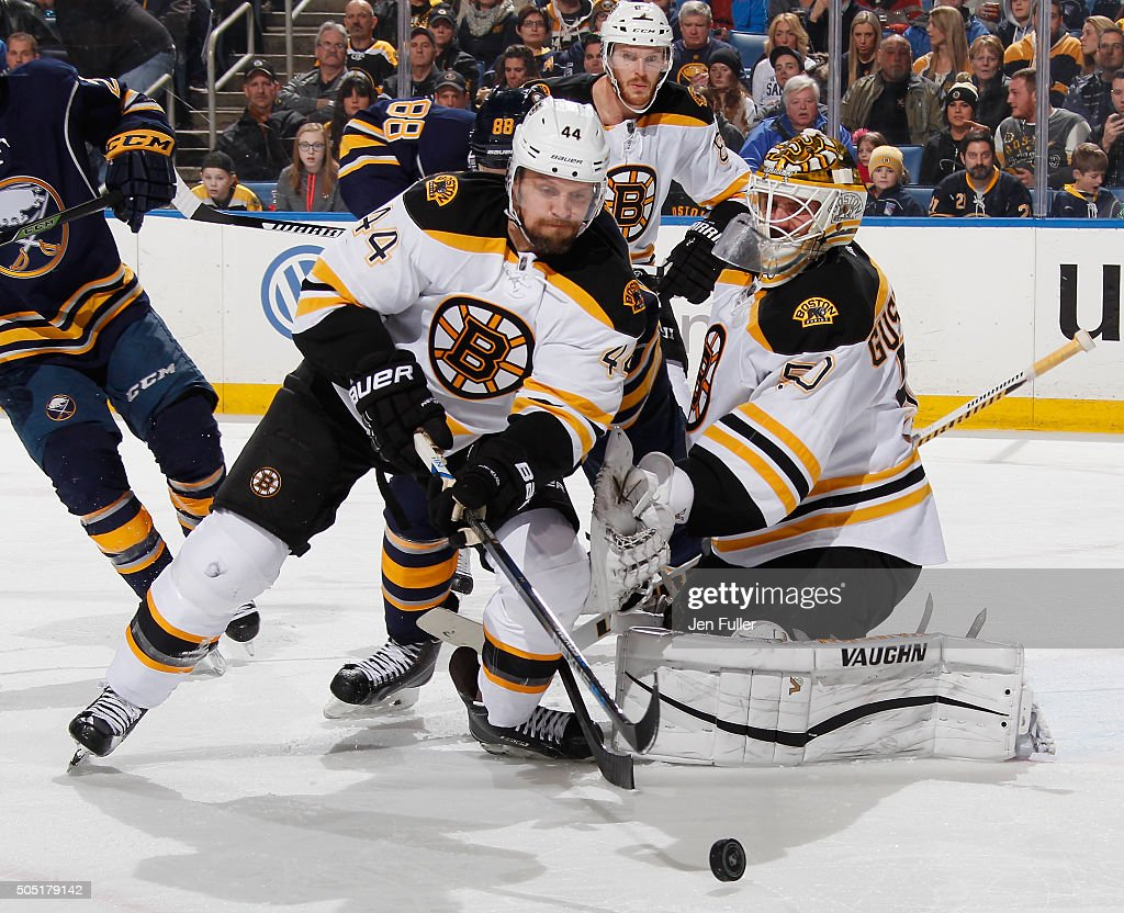 Jonas Gustavsson #50 and Dennis Seidenberg #44 of the Boston Bruins defend the net against Jamie McGinn #88 of the Buffalo Sabres at First Niagara Center on January 15, 2016 in Buffalo, New York.