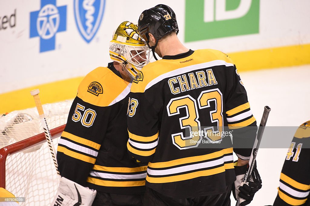 Jonas Gustavsson #50 and Zdeno Chara #33 of the Boston Bruins celebrate a win against the Minnesota Wild at the TD Garden on November 19, 2015 in Boston, Massachusetts.