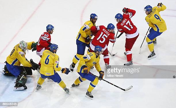 Jonas Gustavsson Magnus Johansson Johnny Oduya Niklas Persson and Tony Martensson of Sweden outnumber Tomas Rolinek Jan Marek and Jaroslav Hlinka of...