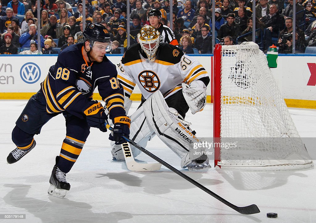 Jonas Gustavsson #50 of the Boston Bruins defends the net as Jamie McGinn #88 of the Buffalo Sabres looks for a shot at First Niagara Center on January 15, 2016 in Buffalo, New York.