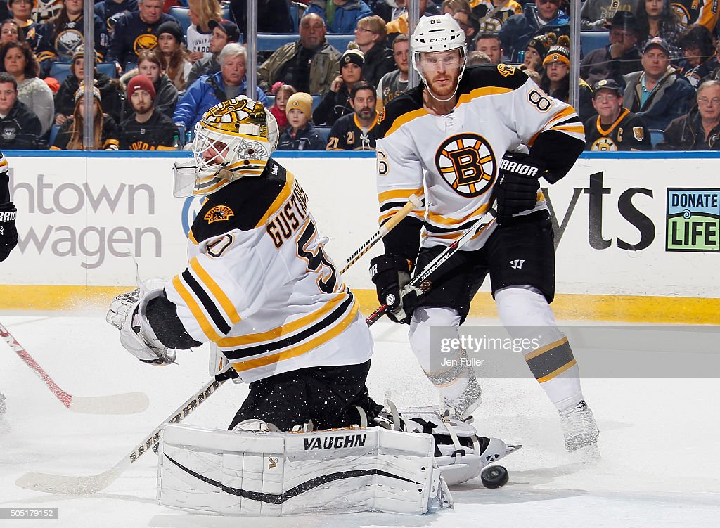Jonas Gustavsson #50 of the Boston Bruins makes a save against the Buffalo Sabres alongside teammate Kevan Miller #86 at First Niagara Center on January 15, 2016 in Buffalo, New York. Boston defeated Buffalo 4-1.