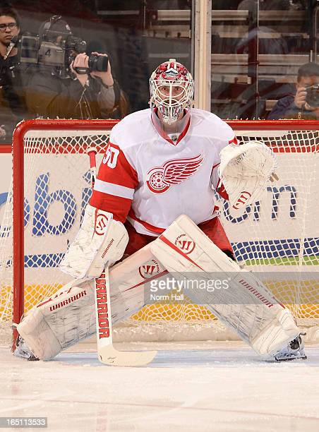 Jonas Gustavsson of the Detroit Red Wings gets ready to make a save against the Phoenix Coyotes at Jobingcom Arena on March 25 2013 in Glendale...
