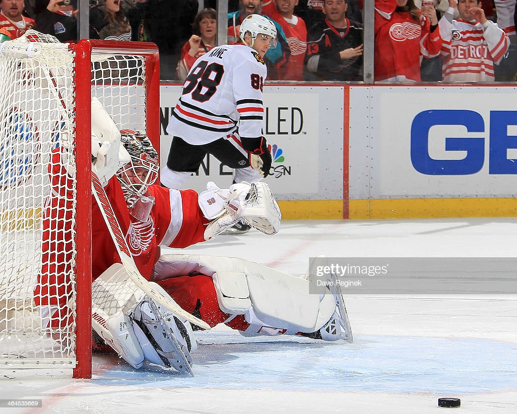 Jonas Gustavsson #50 of the Detroit Red Wings makes a save on Patrick Kane #88 of the Chicago Blackhawks during a shootout in an NHL game on January 22, 2014 at Joe Louis Arena in Detroit, Michigan. Detroit defeated Chicago 5-4 in a shootout
