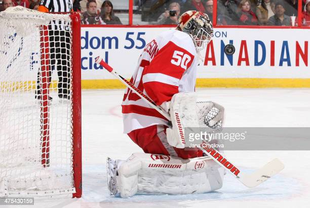 Jonas Gustavsson of the Detroit Red Wings makes one of thirtyseven saves against the Ottawa Senators during an NHL game at Canadian Tire Centre on...