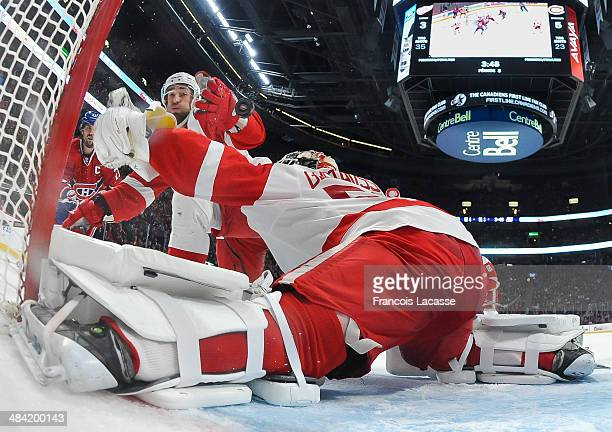 Jonas Gustavsson of the Detroit Red Wings stops a shot against the Montreal Canadiens during the NHL game on April 5 2014 at the Bell Centre in...