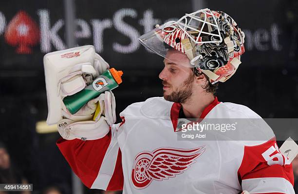 Jonas Gustavsson of the Detroit Red Wings takes a drink during NHL game action against the Toronto Maple Leafs December 21 2013 at the Air Canada...