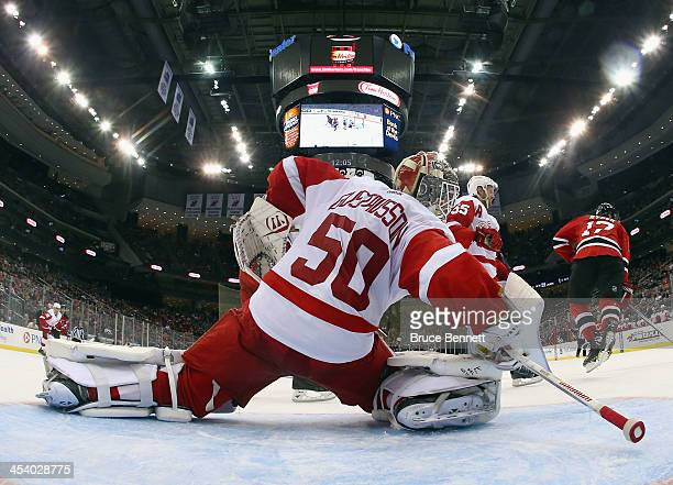 Jonas Gustavsson of the Detroit Red Wings tends net against the New Jersey Devils at the Prudential Center on December 6 2013 in Newark New Jersey...