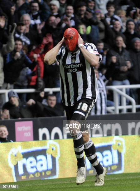 Jonas Gutierrez dons his Spider Man mask after he scored the fourth goal during the CocaCola championship match between Newcastle United and Barnsley...