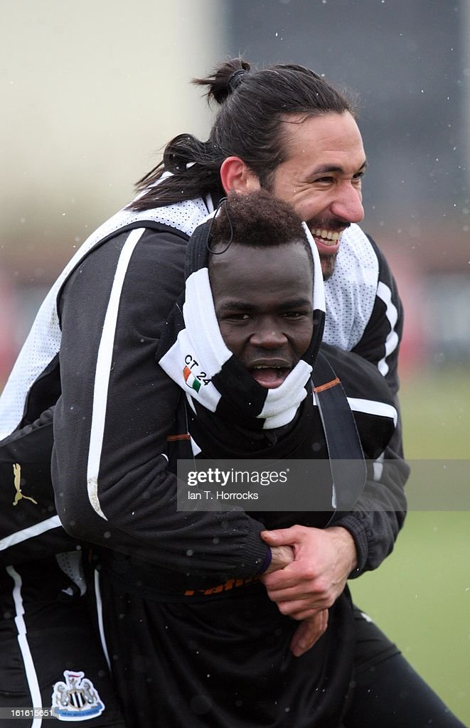 Jonas Gutierrez gets a piggy back from Cheik Tiote during a Newcastle United Training Session at the Little Benton training ground on February 13, 2013 in Newcastle upon Tyne, England.