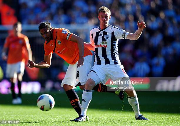 Jonas Gutierrez of Newcastle and Chris Brunt of West Brom compete for the ball during the Barclays Premier League match between West Bromwich Albion...