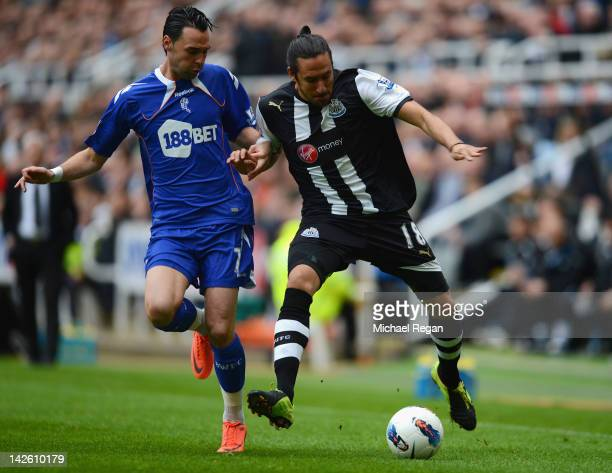 Jonas Gutierrez of Newcastle battles Chris Eagles of Bolton during the Barclays Premier League match between Newcastle United and Bolton Wanderers at...