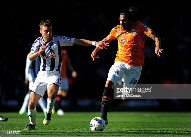 Jonas Gutierrez of Newcastle holds off the challenge from James Morrison of West Brom during the Barclays Premier League match between West Bromwich...