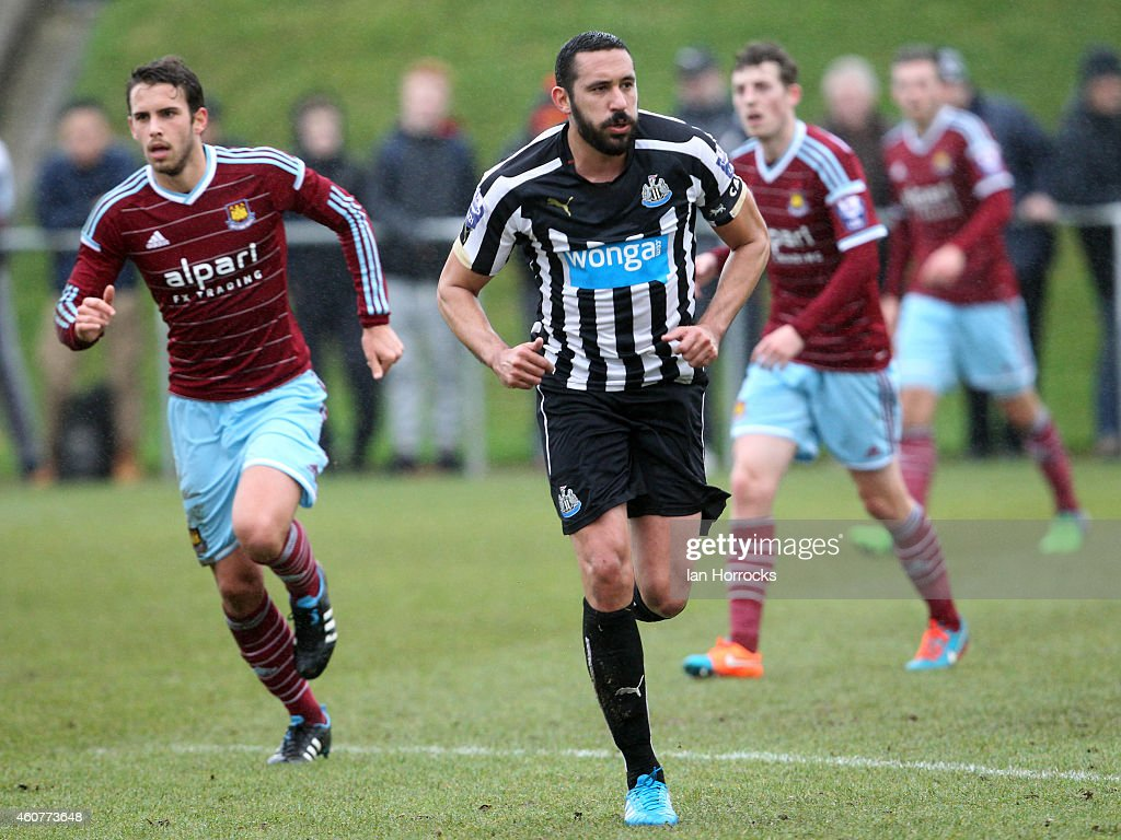 Jonas Gutierrez (R) of Newcastle plays his first game since recovering from cancer with Diego Poyet of West Ham (L) during the Barclays U21 Premier League between Newcastle United and West Ham at Whitley Park Park on December 22, 2014 in Newcastle, England.