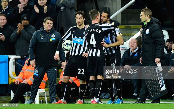 Jonas Gutierrez of Newcastle replaces Ryan Taylor during the Barclays Premier League match between Newcastle United and Manchester United at St...