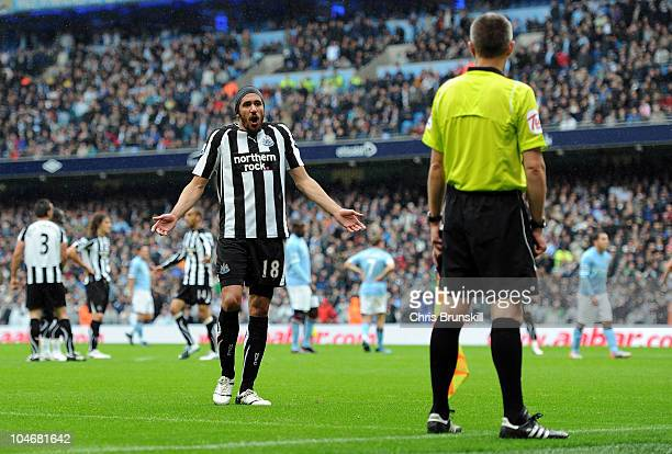 Jonas Gutierrez of Newcastle United complains to the assistant referee after the award of a penalty during the Barclays Premier League match between...