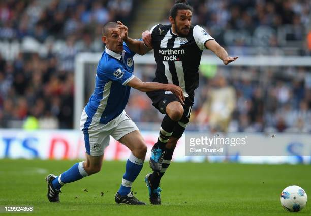 Jonas Gutierrez of Newcastle United in action with David Jones of Wigan Athletic during the Barclays Premier League match between Newcastle United...