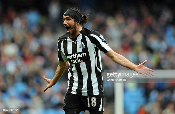Jonas Gutierrez of Newcastle United screams at the assistant referee after the award of a penalty during the Barclays Premier League match between...