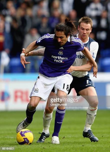 Jonas Gutierrez of Newcastle United vies for the ball with Matt Taylor of Bolton Wanderers during the Barclays Premier League match between Bolton...