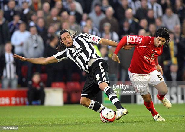 Jonas Gutierrez shields the ball from Hugo Colace during the CocaCola Championship game between Barnsley and Newcastle United at the Oakwell ground...