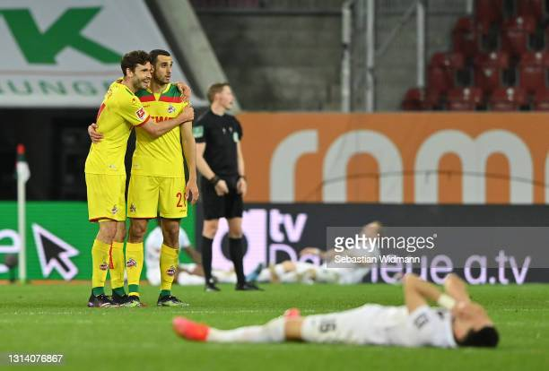 Jonas Hector and Ellyes Skhiri of 1. FC Koeln celebrate their side's victory after the Bundesliga match between FC Augsburg and 1. FC Koeln at...
