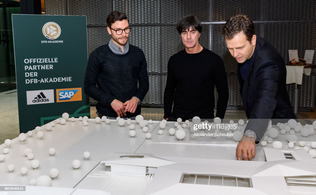Jonas Hector, Joachim Loew and Oliver Bierhoff are seen during the 1st International DFB Game Analysis Congress - Press Conference on November 30, 2017 in Frankfurt am Main, Germany.