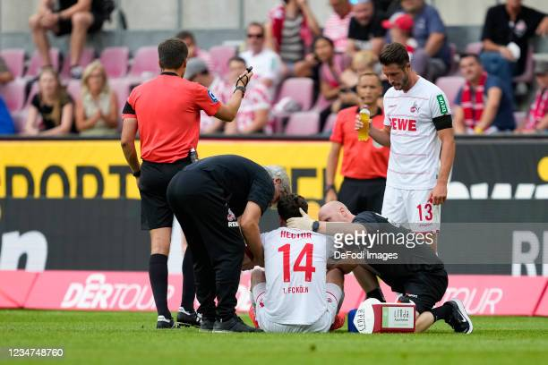 Jonas Hector of 1.FC Koeln receives medical treatment during the Bundesliga match between 1. FC Koeln and Hertha BSC at RheinEnergieStadion on August...